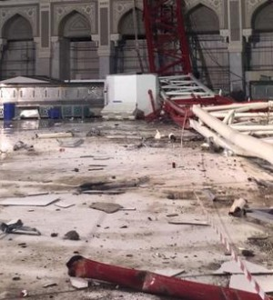A picture taken on September 11, 2015 inside the Grand Mosque of Saudi Arabia's holy Muslim city of Mecca  shows a construction crane after it crashed into it. A massive construction crane crashed into the Grand Mosque in stormy weather, killing at least 87 people and injuring 184, Saudi authorities said, less than a fortnight before the hajj pilgrimage starts.  AFP PHOTO / STR        (Photo credit should read -/AFP/Getty Images)